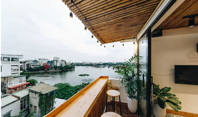 Cozy one bedroom apartment rental with rooftop, Truc Bach Lake view